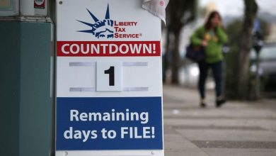 An advertising sign, which remains one day before the registration deadline, is placed in front of the Liberty Tax Service.