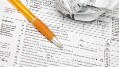 Tax forms with pen. Stock image.