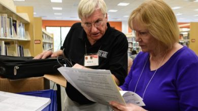 In this 2019 archive photo, AARP Tax Aide Site Managers Ron DiLonardo (left) and Ransi Stephenson (volunteer) review a tax return at the Selby Public Library.  All tax returns are reviewed by another volunteer to ensure quality control.