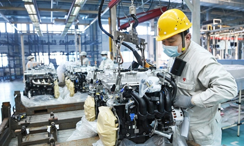 A man works in a workshop of Harbin Dongan Automotive Engine Manufacturing Co., Ltd. on February 25, 2021.  in northeast China's Heilongjiang Province.  (Photo: Xinhua)