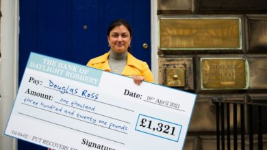 Douglas Ross mocked the personal tax cut when a giant check for £ 1,300 was delivered to his door