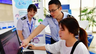 Tax service personnel help a corporate (R) financial officer print a list of tax cuts and fee reductions for their company in Fuzhou, capital of southeast China's Fujian Province, on Aug. 21, 2019.  An Online Service with a Clear List Tax and Fee Reduction was promoted across Fujian Province after it was successfully piloted in Fuzhou City.  Photo: Xinhua