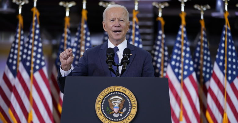 Biden defends the proposed corporate tax hike, saying it will not hold back the economy despite criticism from the CEO