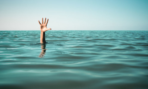 Help drown drowning hand above water 123rf